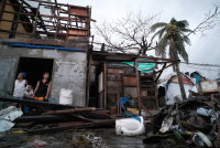 Powerful typhoon rips off roofs, floods parts of Philippines