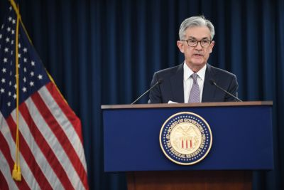 Fed keeps rates on hold, points to 'favorable' economic outlook next year