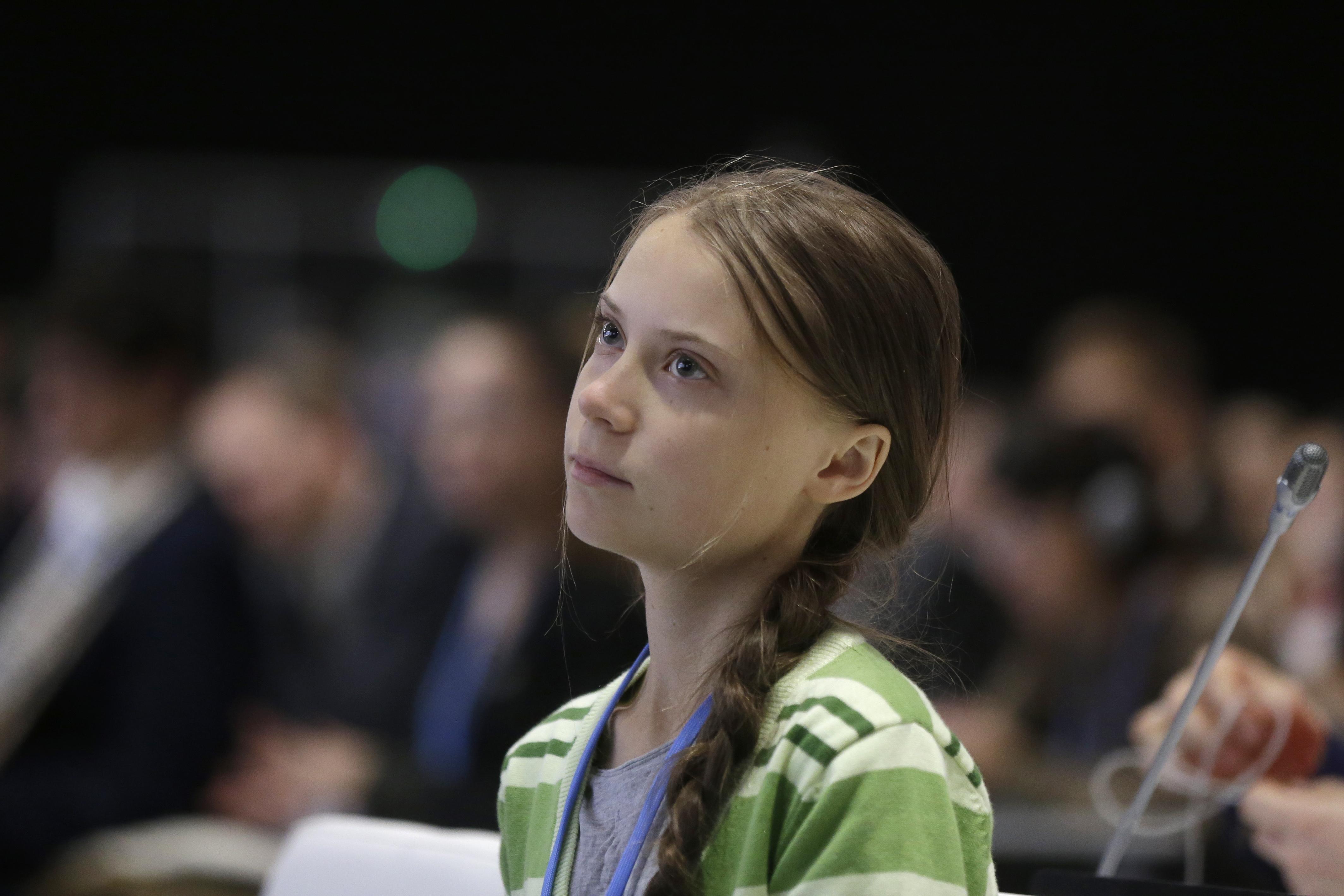 Activist Greta Thunberg sits on floor on homeward-bound German train