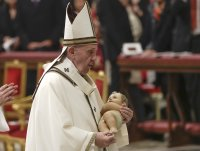 Pope marks joyful Christmas Eve after less-than-joyful year