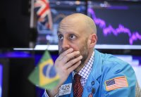 Dow drops over 1,000 as outbreak threatens global economy