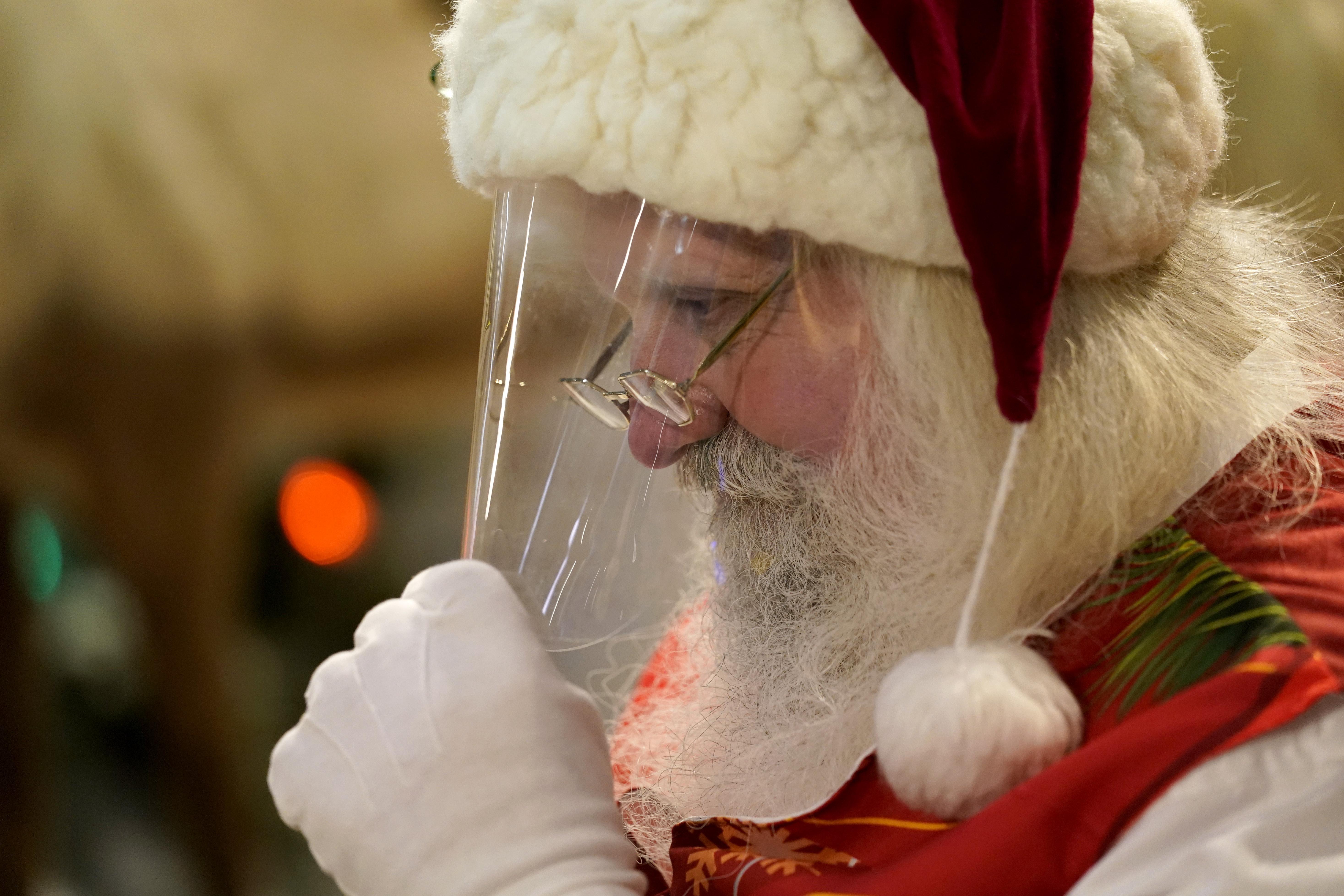 Ho, ho - Whoa! Virus keeping most Santas at a distance