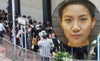 Over a thousand show up for funeral service of Hong Kong singer Ellen Joyce Loo