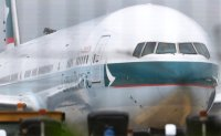 Cathay Pacific passenger arrested after kicking, hitting stewardess