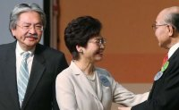 New Hong Kong leader vows to unite divided city