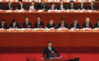 Xi warns party to tackle challenges as China moves into new 'modern socialist' era