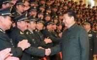 Xi 'plots shake-up' of men running China's massive military machine