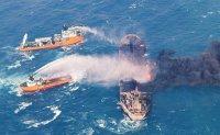 Burning Iranian tanker bound for Korea explodes and sinks