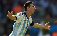 Messi boosts Argentina; Germany draws with Ghana