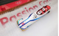 Korea finishes 2nd in opening heats of four-man bobsleigh