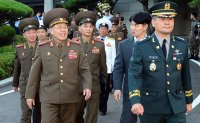 North Korea urges 'frank' talks in meeting with the South, as activity detected at missile factory