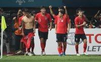 Korea digs deep for epic win over Uzbekistan