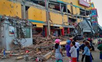 Major Indonesia quake, tsunami kills hundreds
