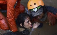 Indonesia tsunami death toll may hit thousands