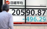 Japanese stocks tumble over US-China trade tensions