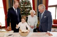 Queen Elizabeth mixes puddings, and sends message of continuity