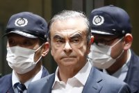 Japanese prosecutors raid Nissan ex-chair Ghosn's Tokyo home