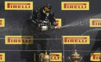 Hamilton wins British GP to close in on Schumacher's record