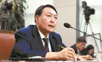 Top prosecutor nominee vows political neutrality