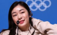 Final torch bearer Kim Yuna says lighting caldron unforgettable