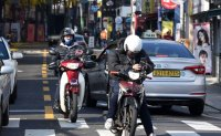 Delivery service companies face hardships securing riders
