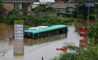 Five rescued from bus caught in flood [PHOTOS]