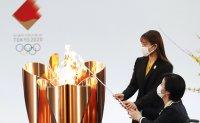 Tokyo Olympics torch relay begins in Fukushima