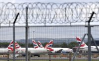 UK flights banned as Britain warns new virus strain 'out of control'