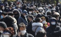 Korea's virus cases top 7,100 amid signs of infection slowdown
