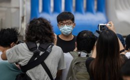 Hong Kong opposition activist Joshua Wong arrested over illegal assembly and anti-mask law