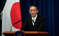 Japan, Vietnam agree to boost defense ties, resume flights