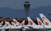 Taiwanese air passengers warned over use of 'Wuhan coronavirus' on travel papers