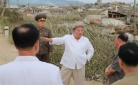 North Korean leader holds party meeting during visit to typhoon-hit area