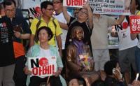 15,000 protesters condemn Abe