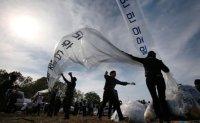 US report slams Seoul's anti-NK leaflet ban, ruling bloc's corruption scandals