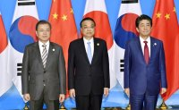 South Korea, Japan, China confirm joint push for peaceful denuclearization