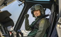 Cho becomes first female chopper pilot at Korean Marines
