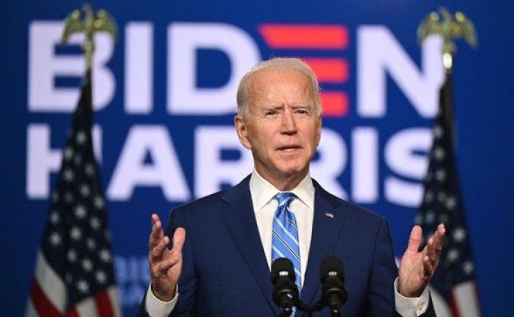 Biden officially secures enough electors to become president