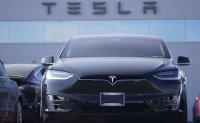 Tesla reports $721 million in 2020 earnings, first profitable year