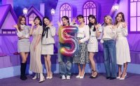 TWICE says 2nd full album shows group's more daring, dark side