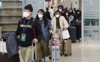 Korean chartered plane returns with some 300 nationals from virus-hit Italy