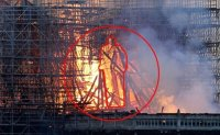 Jesus standing in Notre Dame cathedral fire? [PHOTOS]