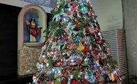 Indonesian church decorates Christmas tree with masks, sanitizers to promote COVID awareness