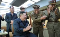North Korea says it tested 'new weapon' under leader Kim's guidance