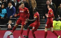 Firmino fires ruthless Liverpool 16 points clear