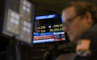 Stocks go on a wild ride as virus threatens economic damage