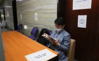 Lawmaker's aides spend five days waiting for 'first bill' title