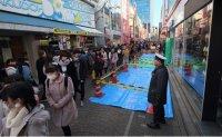 Cult follower rams van into Tokyo crowd 'in retaliation'