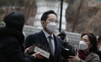 Uncertainty heightens over Samsung as heir ordered back to prison for bribery