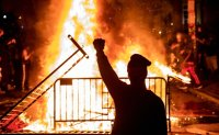 Pandemic forgotten in US amid riots